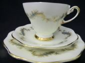 E Brain china Blue & gilt  feathers tea trio